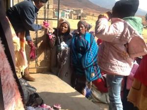 Community members receiving their clothing